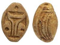 "Oval limestone bead with geometric design. 2nd Intermediate Period.  Size: ½""  Date: 1640 BC - 1532 BC"