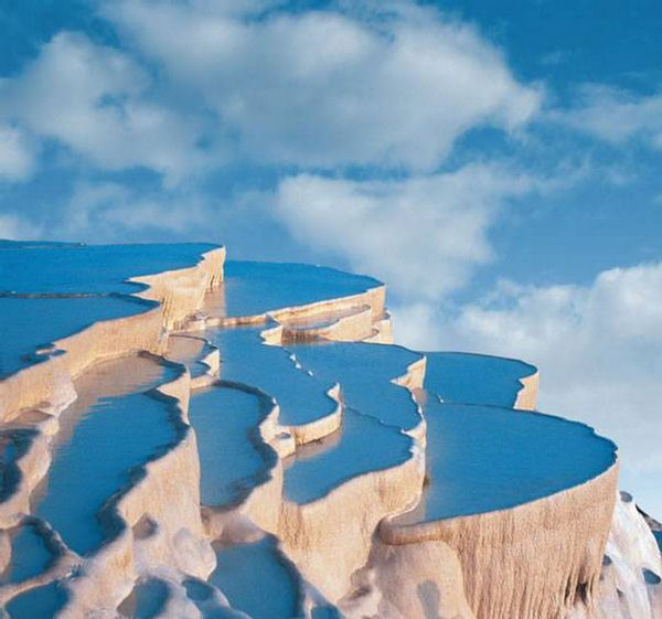 """Natural Infinity Pool - Pamukkale, Denizli, Turkey  Pamukkale, meaning """"cotton castle"""" in Turkish, is a natural site in Denizli Province in southwestern Turkey. The city contains hot springs and travertines, terraces of carbonate minerals left by the flowing water. It is located in Turkey's Inner Aegean region, in the River Menderes valley, which has a temperate climate for most of the year."""