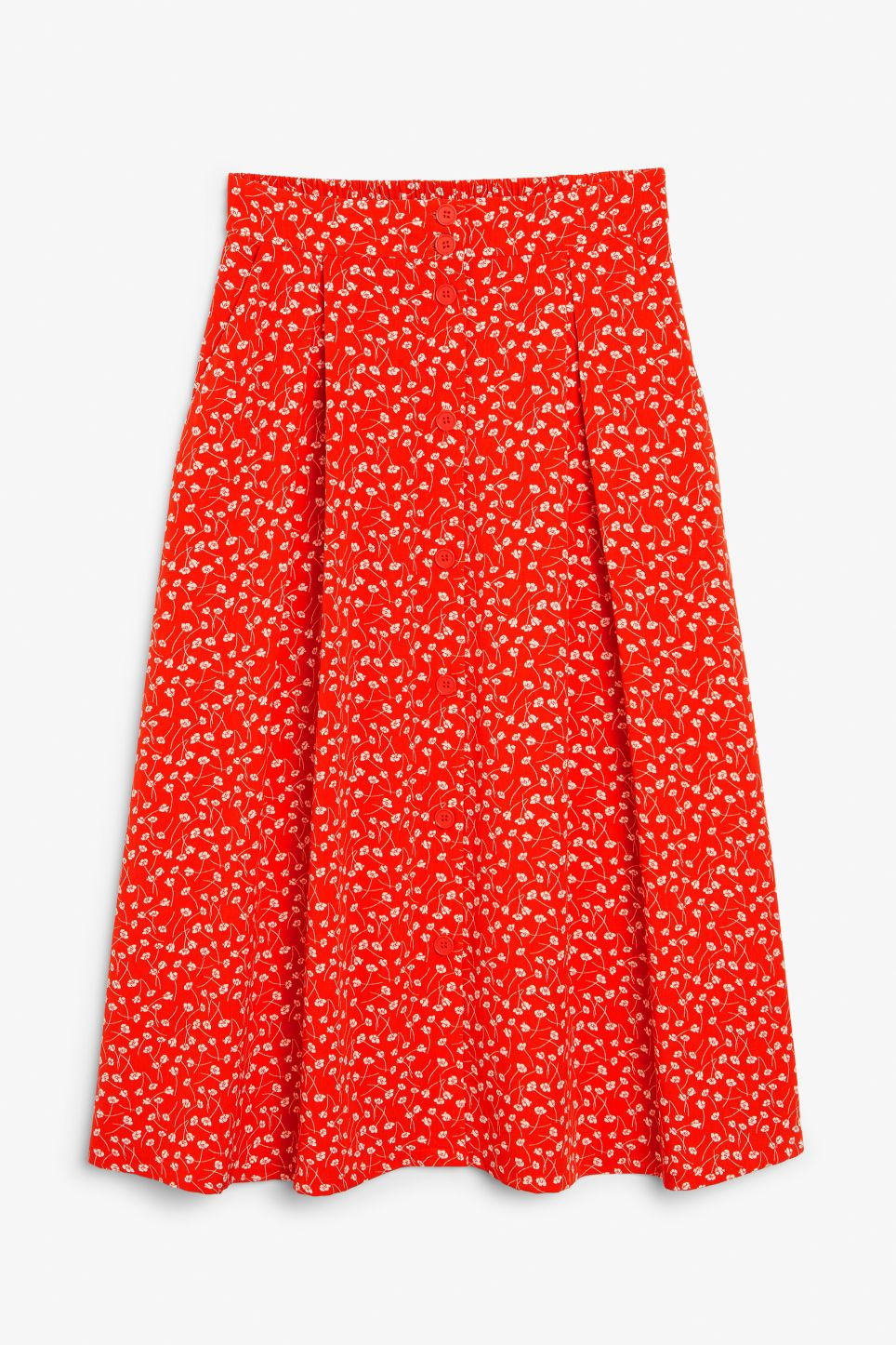 c03beb99ce6f Pleated midi skirt - Floral print - Skirts - Monki A flowy midi skirt with  slanted front pockets and buttons all the way down to the hem.