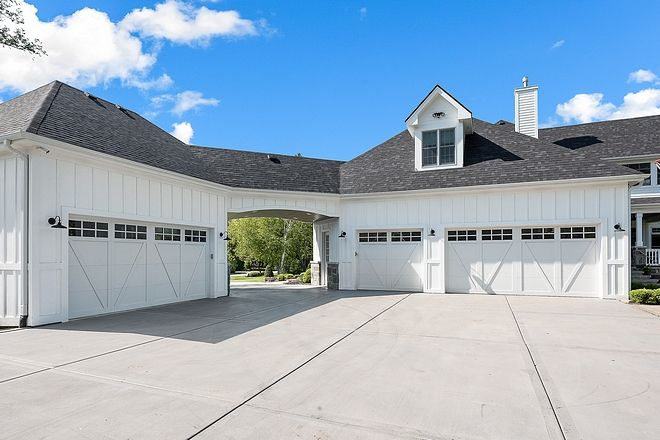 Board and Batten Garage with porte cochere This home features a 3