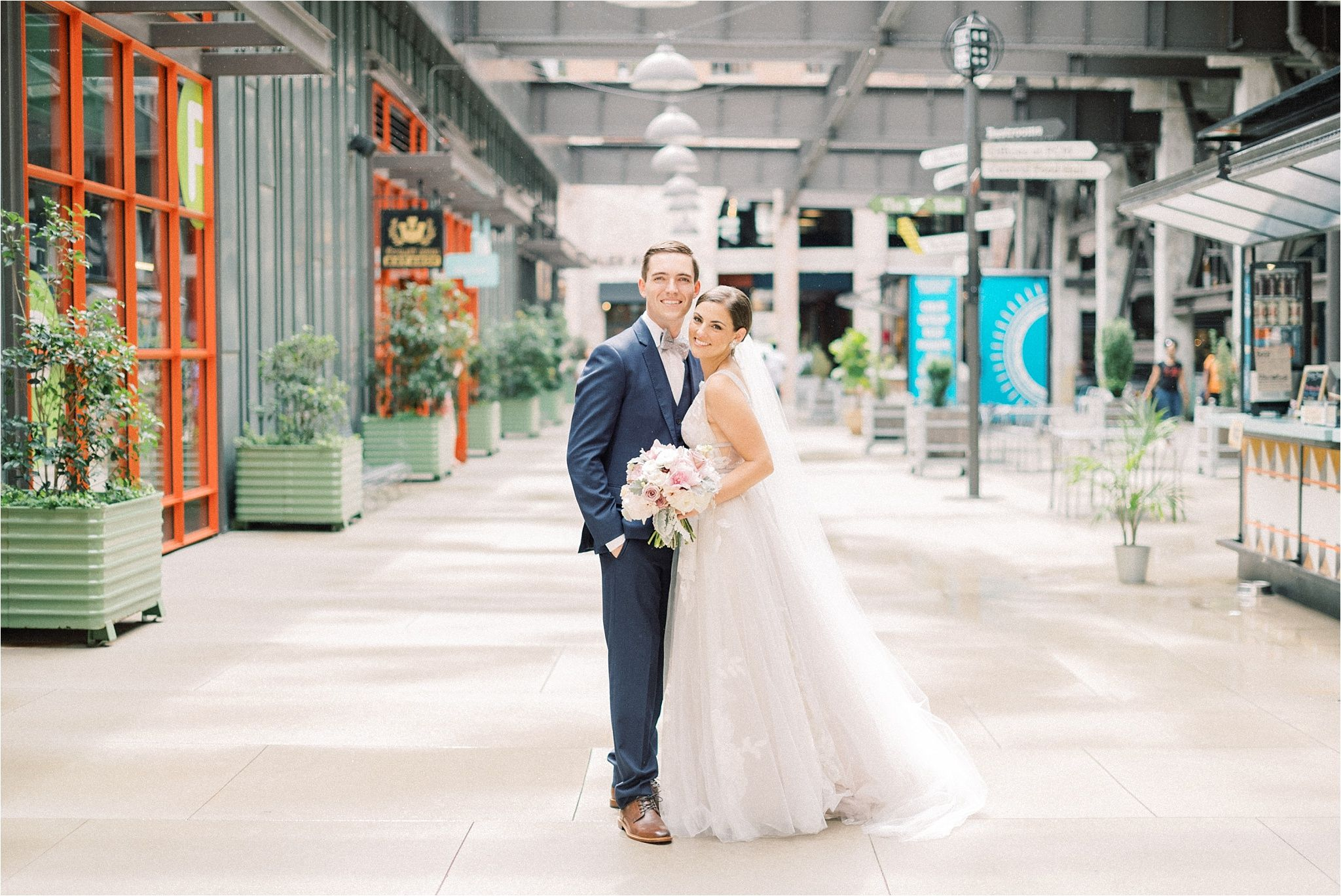Ponce City Market Roof Top Terrace Atlanta Ga Wedding Bhldn Hearst Gown Navy Groomsmen Suit With Bowtie Simple Boho Modern City Market Ponce Wedding Moments