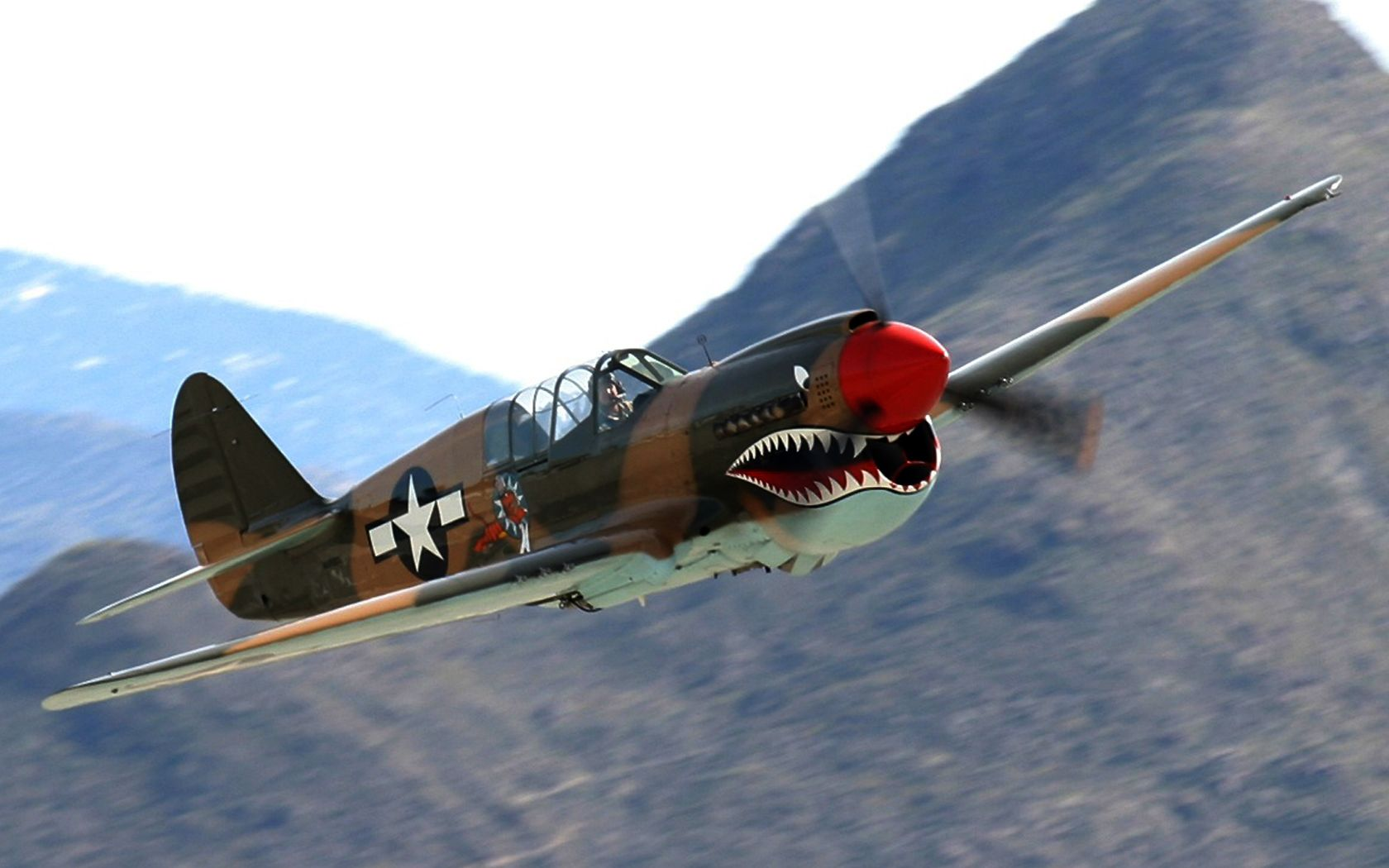 Flying Tigers' P40 Here's the engine sound on take-off ...