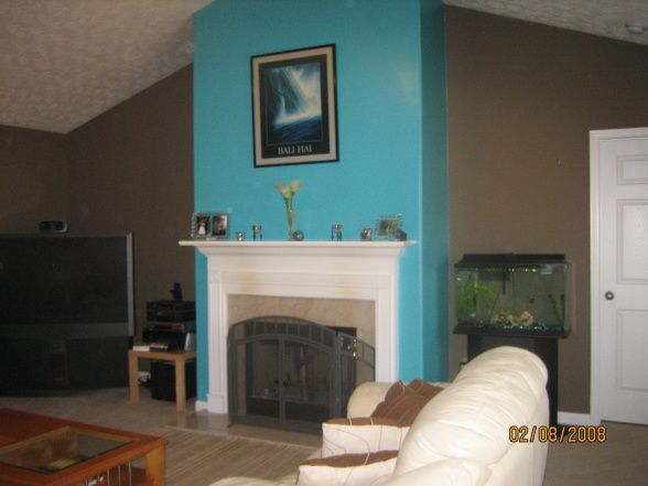 Bali Hai, Brown living room with turquoise wall around fireplace ...