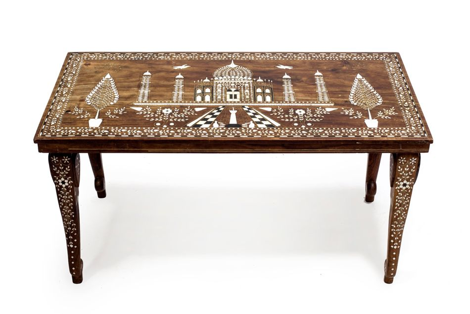 This is a fine vintage Indian coffee table made from sheesham wood