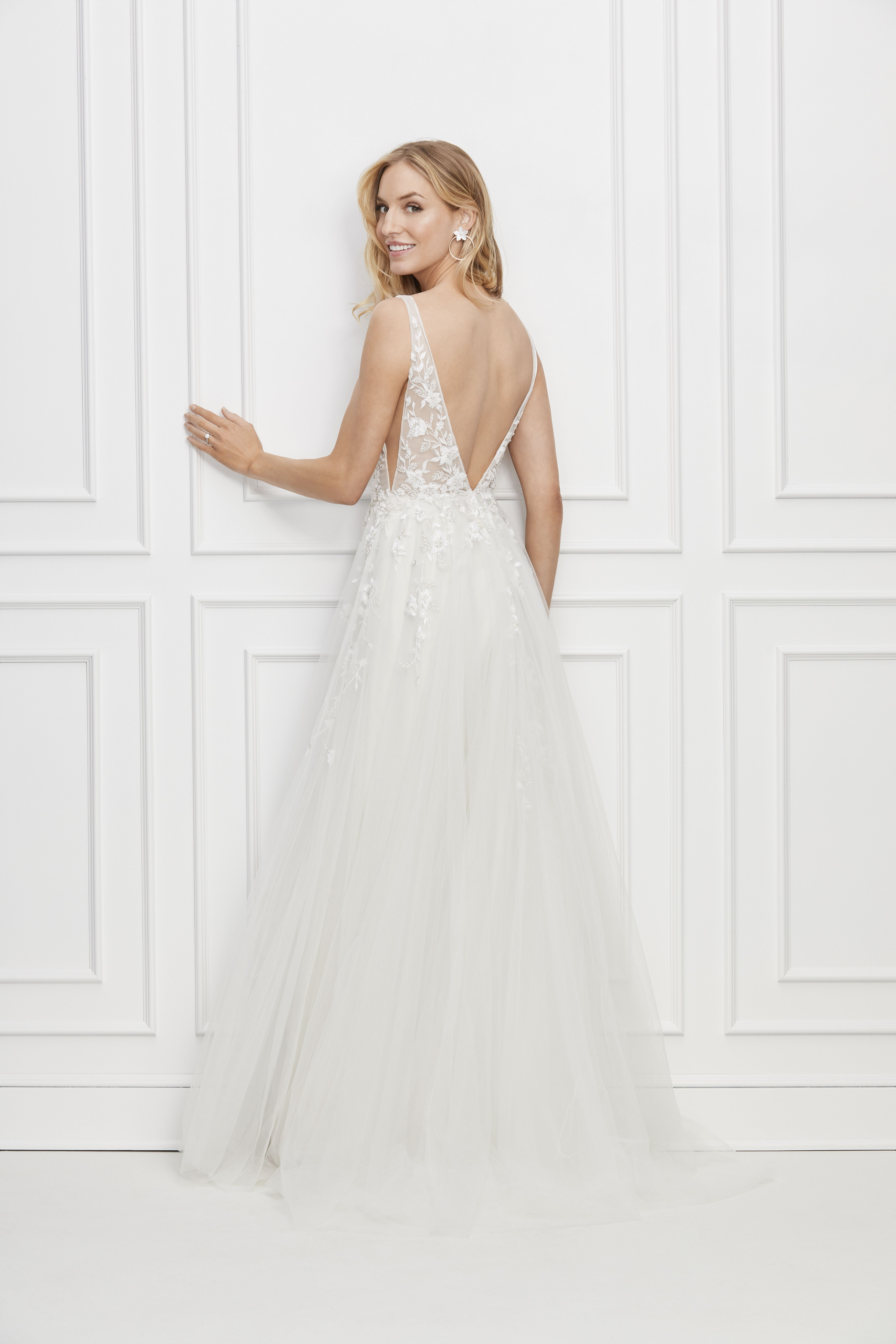 This Plunge Necked Gown Of Tulle Embroidered With Pretty Little
