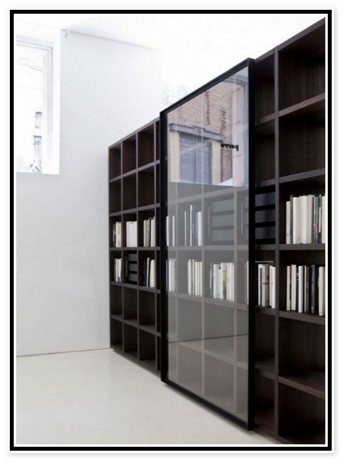 Mural Of White Bookcase With Glass Door For Elgant Interior With