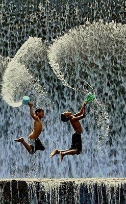 Boys having fun in waterfalls