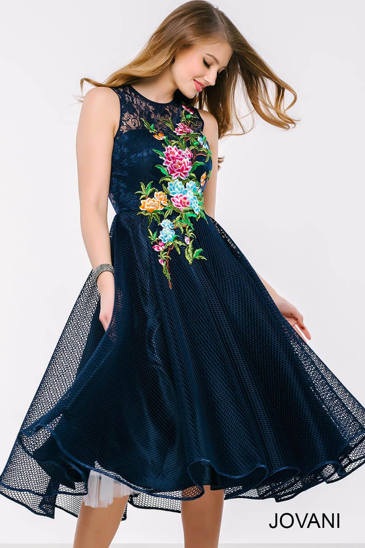 Stunning sleeveless below the knee navy blue cocktail dress features ...