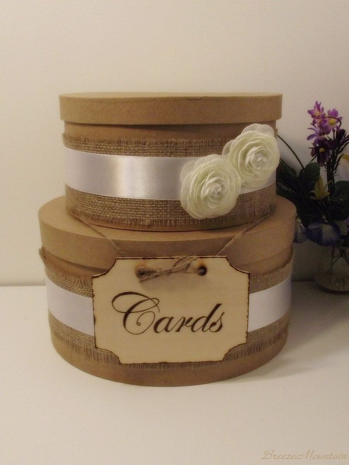 another idea: wedding money box. Plain brown round boxes with burlap ...