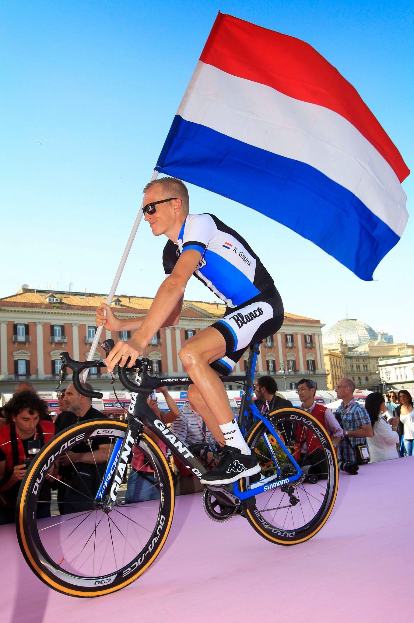 Robert Gesink Of Team Blanco Pro Cycling Carrying The Dutch Flag Pro Cycling Cyclist Cycling