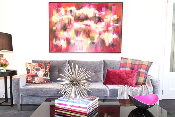 Silver grey custom made sofa with pink decor cushions. Interior ...