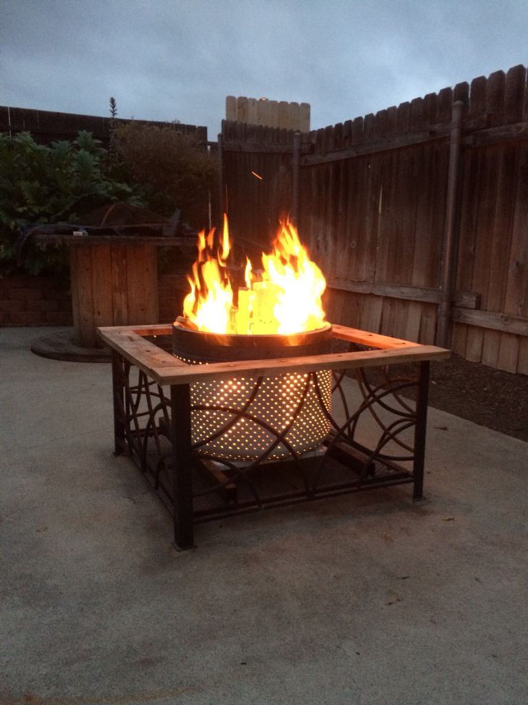 repurpose an old washer drum into a new fire pit for 10 the
