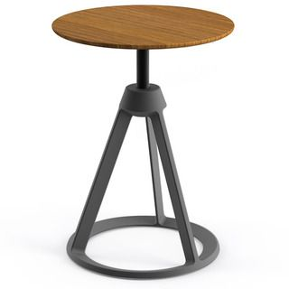 The table's cast-aluminum, powder coated base, which is the same as the stool, is a unique reinterpretation of the familiar tripod structure, with the legs visu
