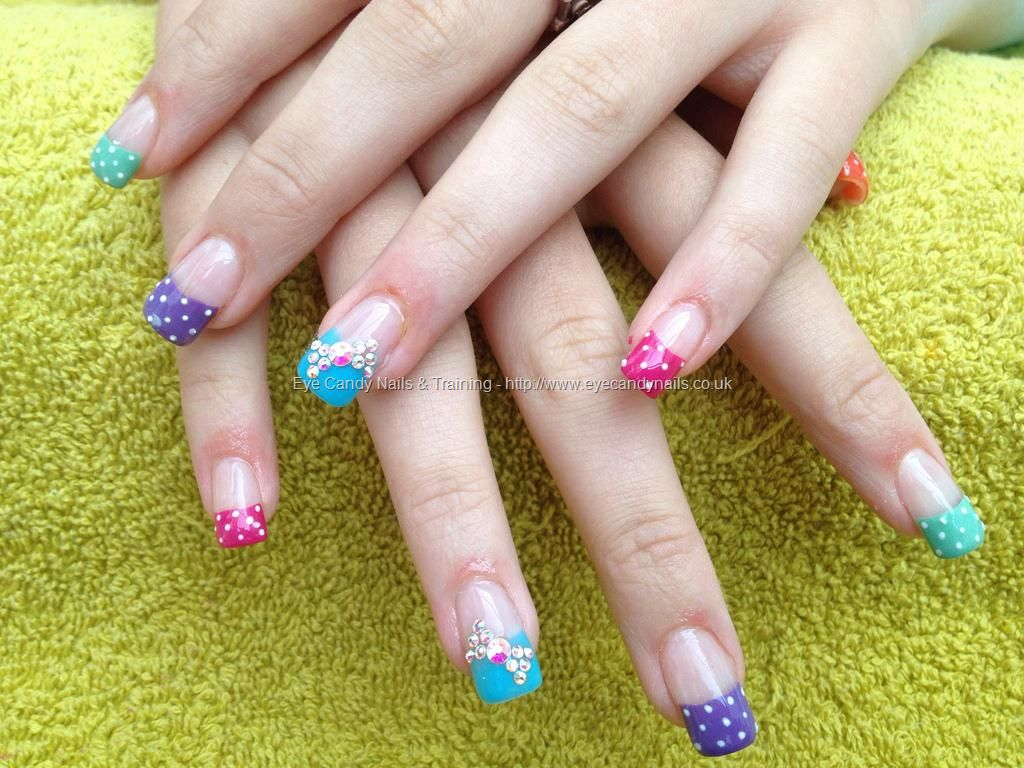 Full set of acrylic nails with different coloured tips with poker ...