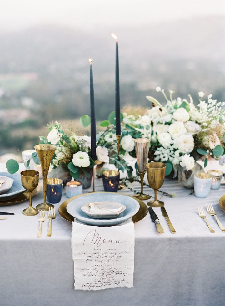 organic wedding tablescape + gold and blue wedding table setting #reception #tablescape #tablesetting & Elegant organic wedding tablescape + dark blue candles + calligraphy ...
