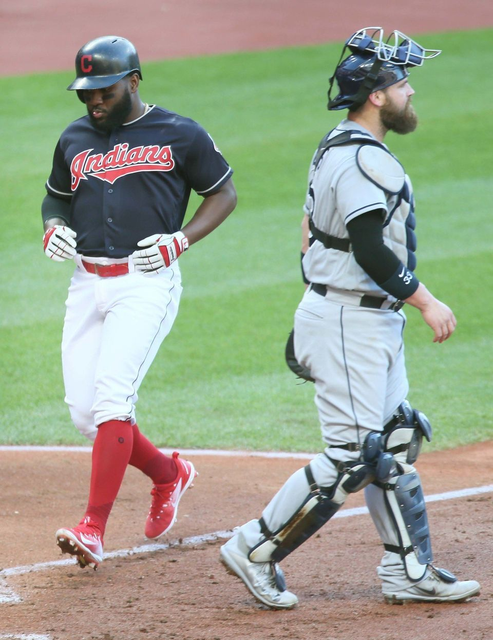 Cleveland Indians Abraham Almonte scores on an errant