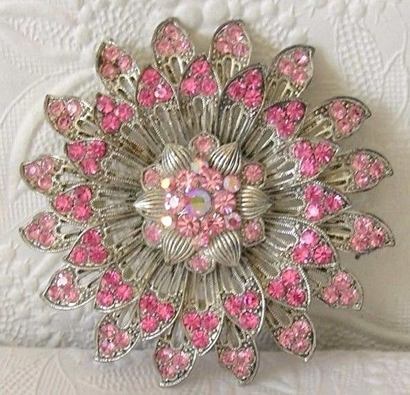 "Silver-tone with Pink Glass Stones. No missing stones. Measures 3"" across (see picture). 