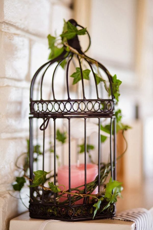 Using Bird Cages For Decor 46 Beautiful Ideas Digsdigs Bird Cage Decor Vintage Bird Cage Decor Vintage Bird Cage