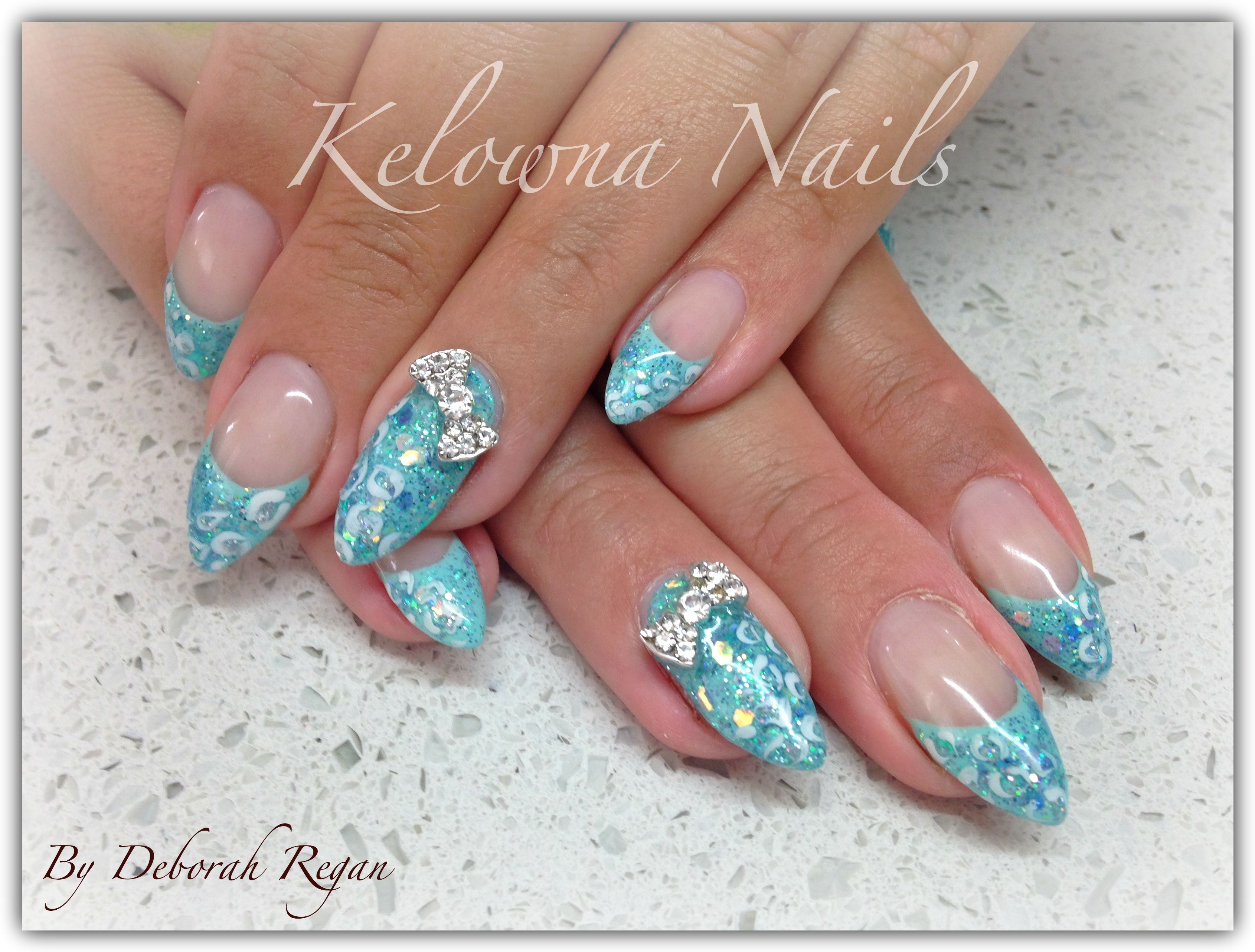En vogue ~ Tiffany Blue with sparkles and bows <3 | Gel Nails ...