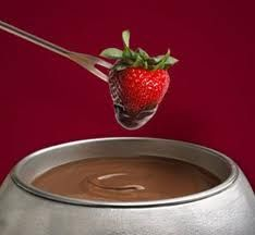 WHITE CHOCOLATE FONDUE: 2 (11 ounce) packages ghiradelli white chocolate chips  ¼ cup heavy cream  1 ounce Amaretto