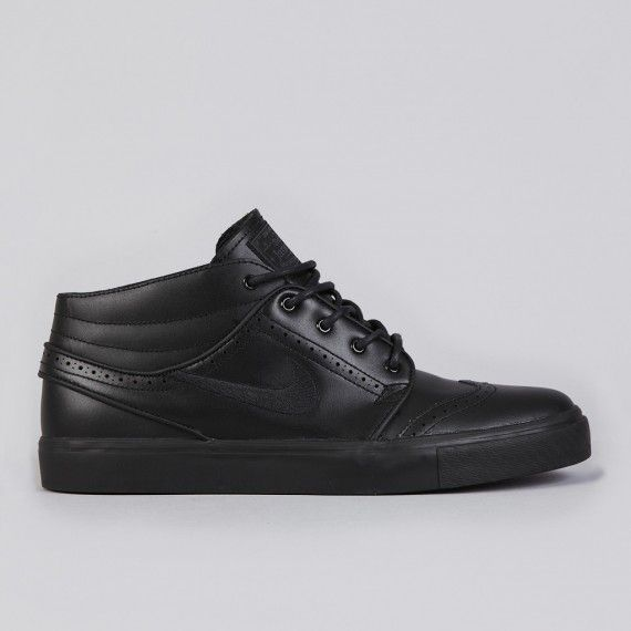 The Nike SB Zoom Stefan Janoski Mid is back in another brogue build, styled  in an all-black premium leather.