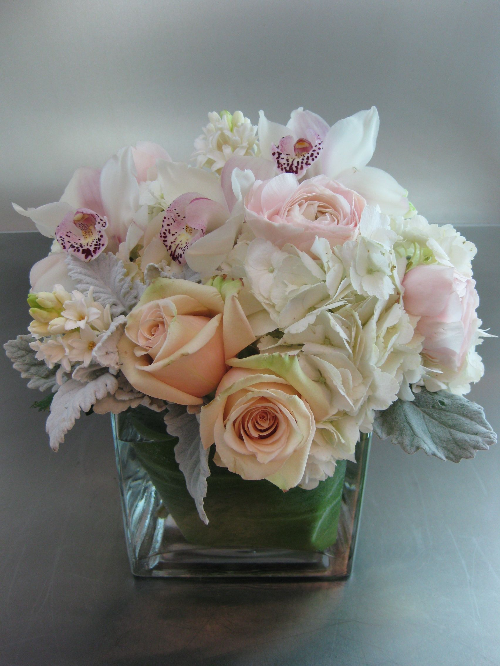 White Peach Pink Gray With Cymbidium Orchids Re Pinned By Www Westpointorchids Com Modern Flower Arrangements Cymbidium Orchids Modern Flower