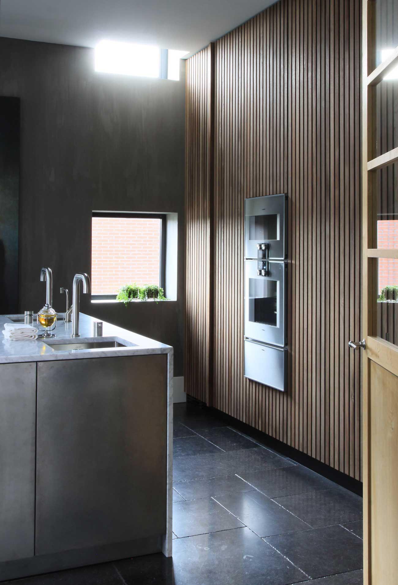 Modern Minimal Kitchen, Black Stone Floors, Slatted Wood Wall, Grey