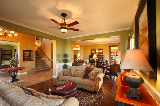 An open concept living room design with earth toned colors ...