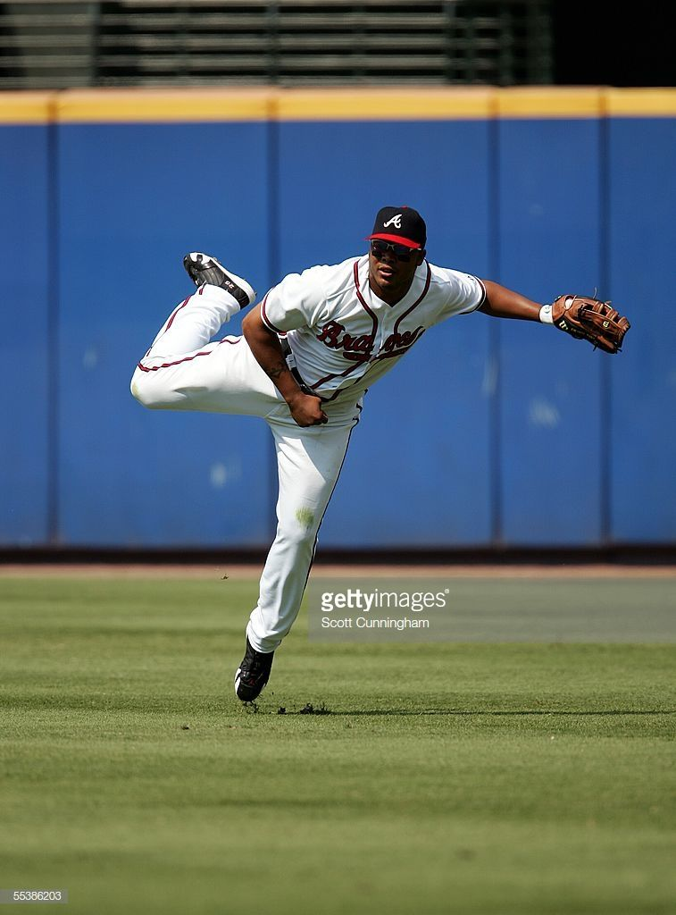 Andruw Jones Of The Atlanta Braves Throws Out A Runner Against The Atlanta Braves Braves Atlanta