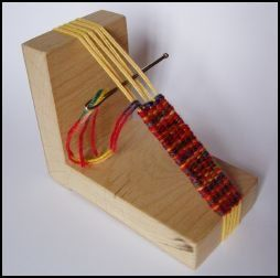 "Found this on www.interweave.com  It's by Alison Irwin and it's called an ""L"" loom.  Lot's of free downloads on this sight!"