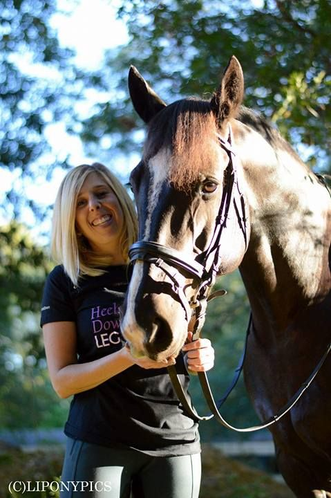 """Alana S. with her """"Heels Down Leg On"""" dressage tee and her handsome horse, Onyx."""