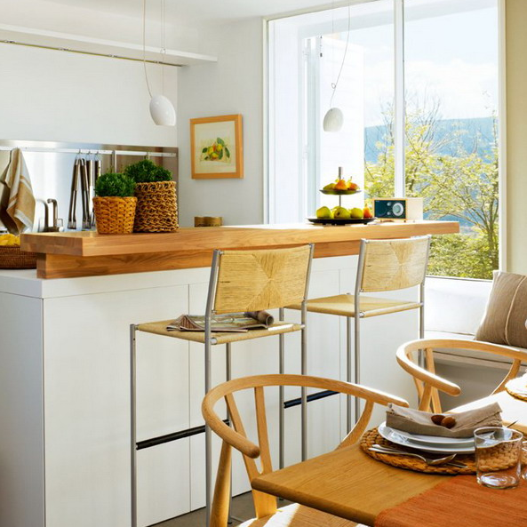 The Kitchen Island Features A Breakfast Space Or A Mini Bar Countertop Kitchen Design Cozy Kitchen Dining Area