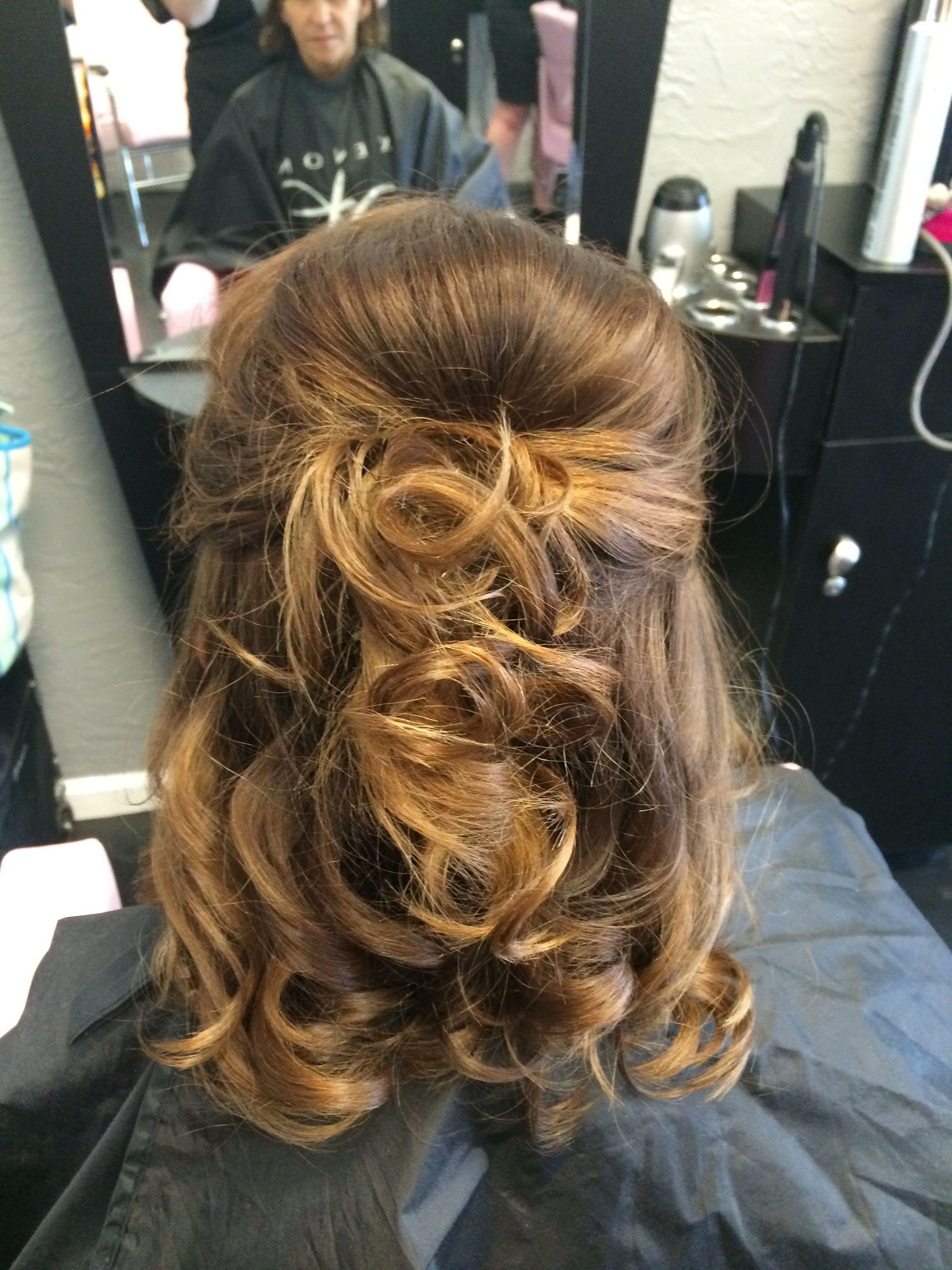 mother of the bride hair. half up half down. medium length
