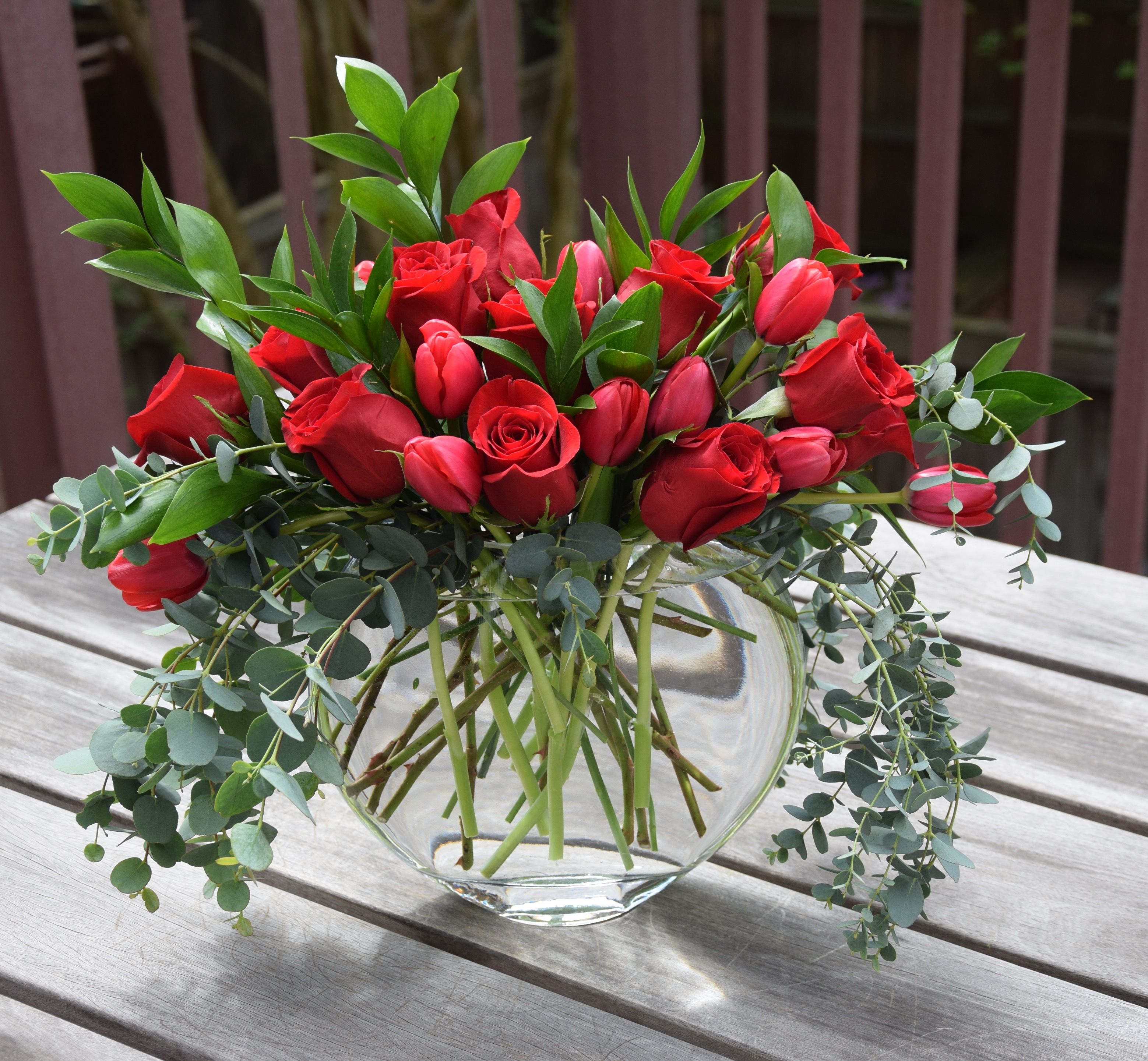 Mother S Day Flower Arrangement With Red Roses And Red Tulips Eucalyptus And Ruscus Leav Fresh Flowers Arrangements Tulips Arrangement Red Flower Arrangements