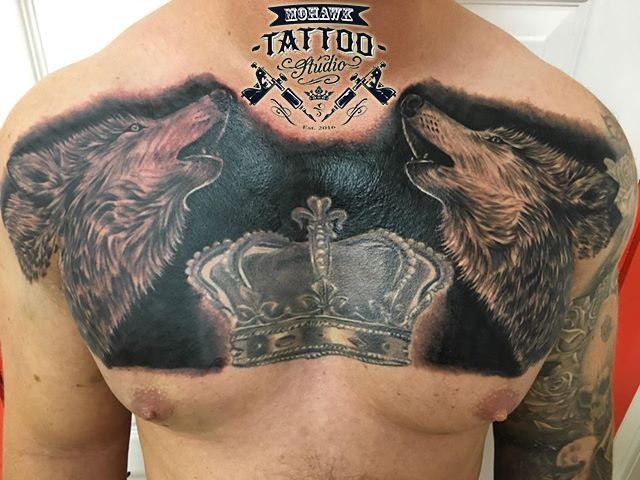 Black and grey twin wolf chest piece coverup.  #wolftattoo #Paisleytattoo #uktattoo #tattoo #tattoos #tattooartists #tattooer #tattooculturemagazine  #inkedmag #tattooartistmagazine @tattoosnob @newtraditionalgallery @neotradtattoo @superb_tattoos @inked_fx @thebesttattooartists
