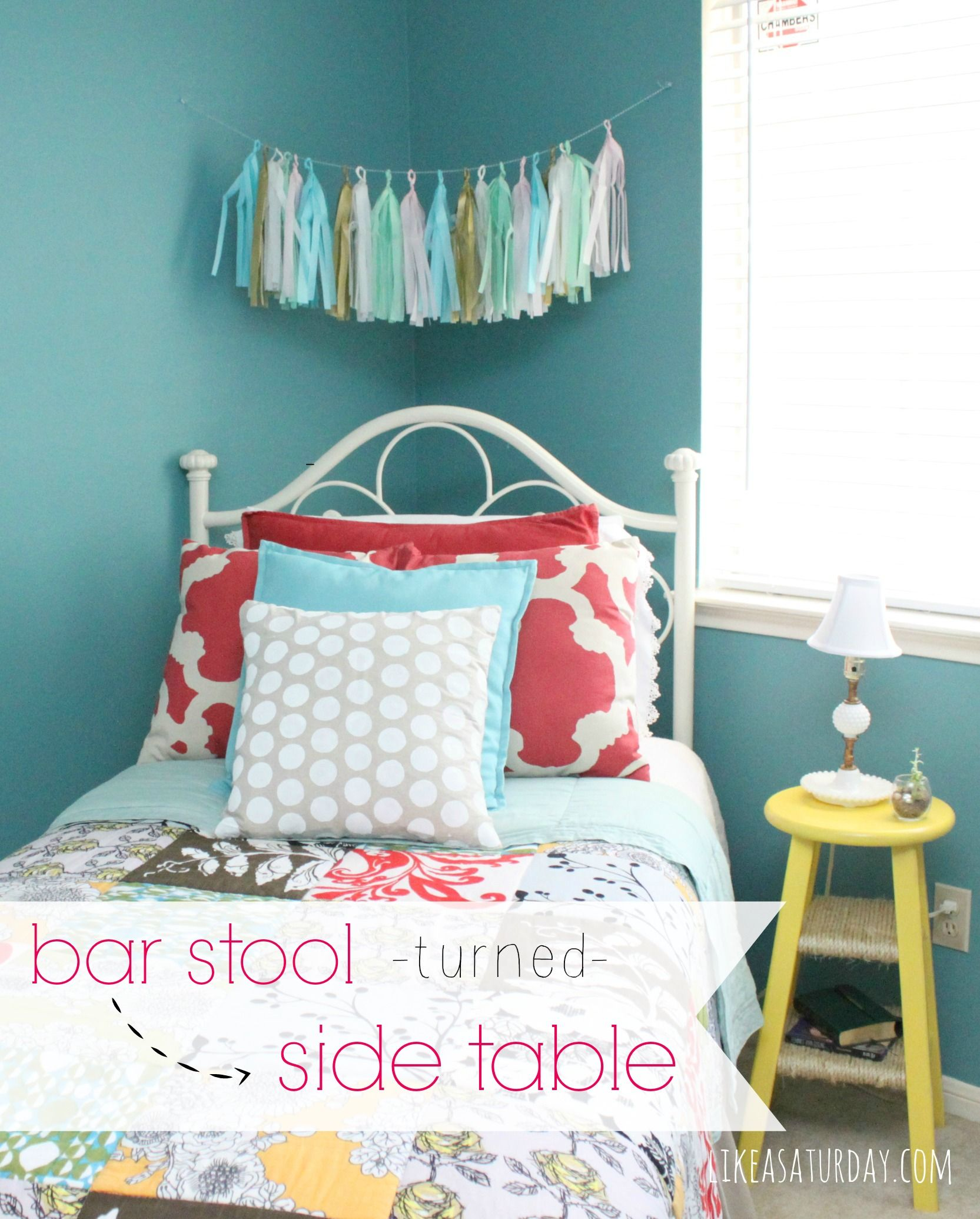 A bar stool turned into a side table for a guest room.