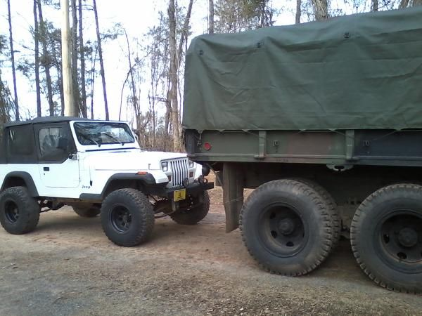 Size Comparison For The Deuce And A Half With A Lifted 1995 Jeep Wrangler Sitting On 33 In Tall Tires These Are Big Trucks While Driv Big Trucks Jeep Jeep Yj