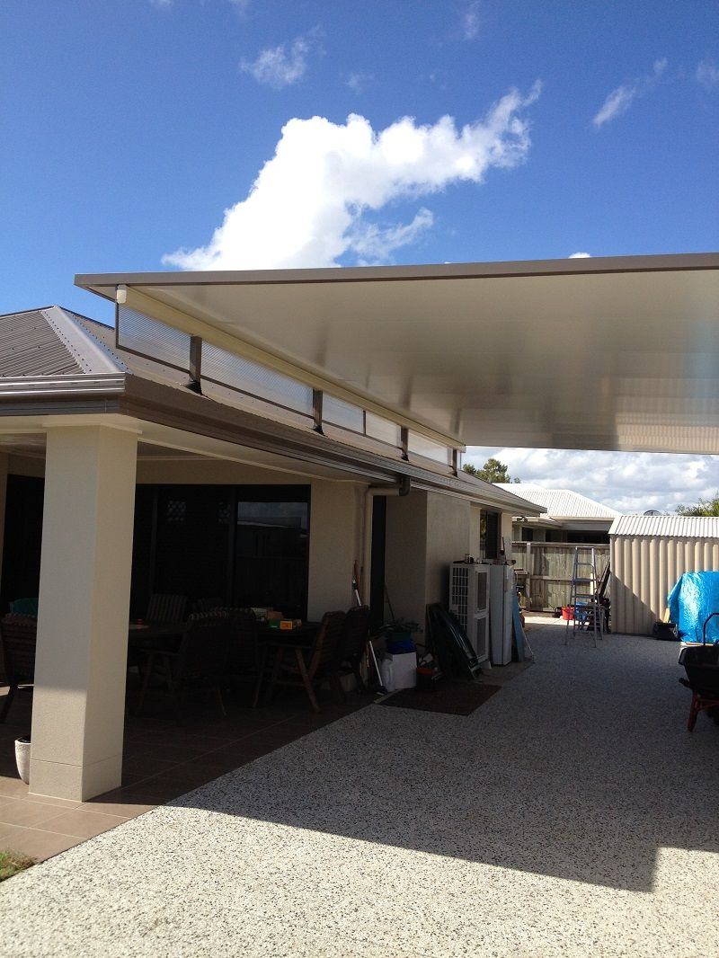 Stratco cooldek fly over carport with twinwall side panels for Carport deck