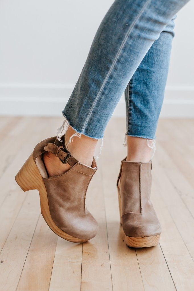 357c3d8e383 Spanish crafted round-toe leather clog boots with side cutouts and a piece  with suede in back. Adjustable ankle strap with buckle closure and wooden  heels ...