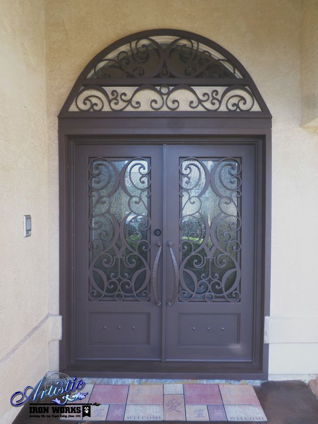Wrought Iron and Glass Front Entry with Arched Window Guard and ...