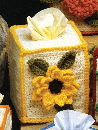 Add a pretty and simple touch of sunshine to your home with this boutique-size tissue topper. Size: Fits standard-size boutique-style tissue box. Made with medium (worsted) weight yarn and size G/6/4mm hook. Skill Level: Intermediate