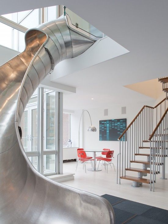 TCA has had a lot of experience connecting smaller apartments together into a seamless whole, this this adventurous client requested something we'd never seen before. IN a newly constructed multi-residential development, in the East Village of NYC, TCA had the opportunity to meet a unique client's desire to combine two penthouse condos...with a helical slide. In this transforma... more »
