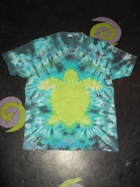 70734f046f5b74 The design features a tie dyed green turtle surrounded by a scrunched  pattern. We make this T shirt with a blue and black scrunch background to