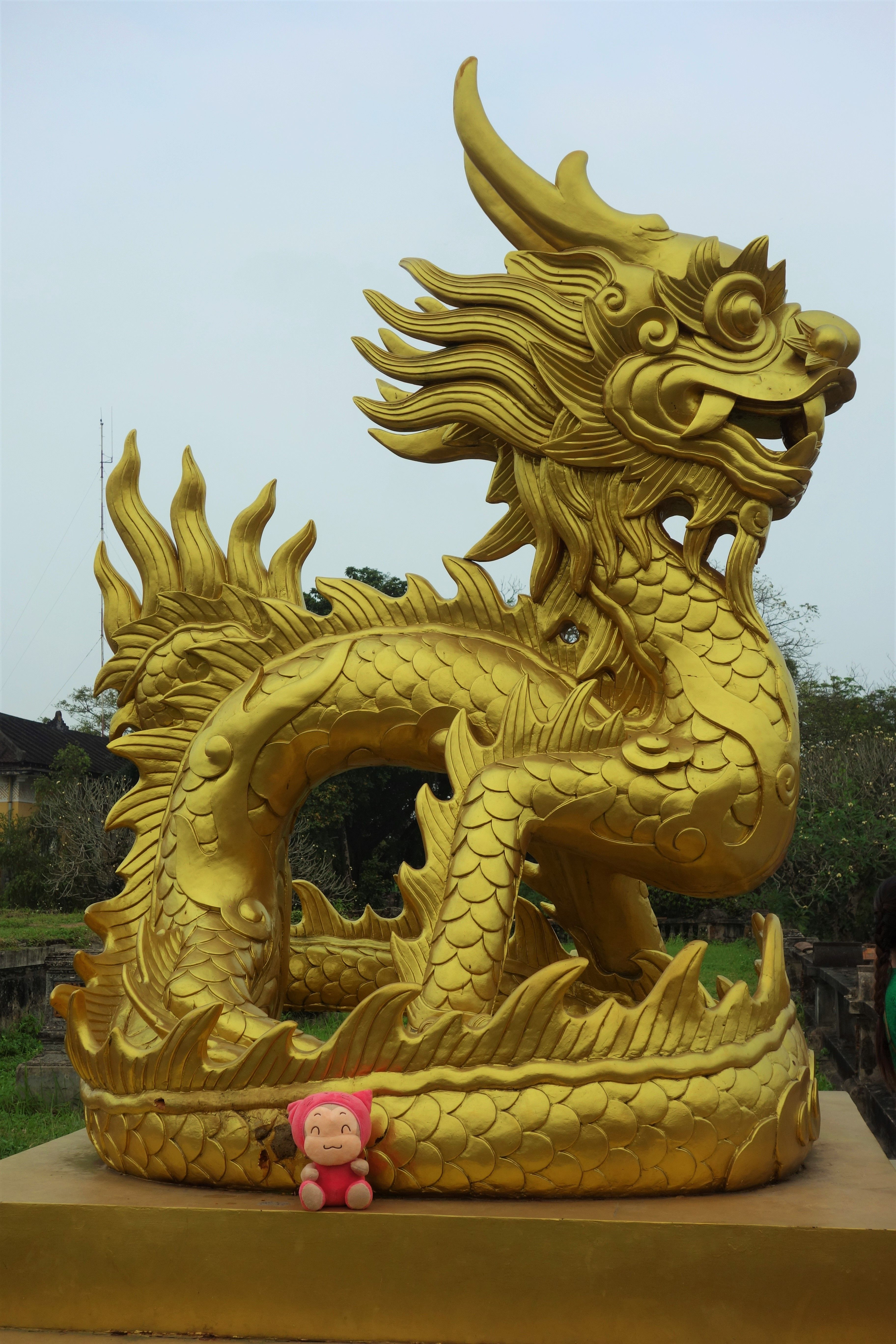 Travel Mascot in Vietnam in front of dragon statue. Travel Blog ...