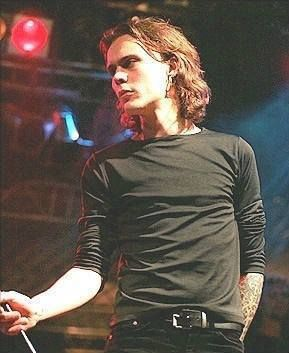 Ville Valo - my idea of brutal perfection. He may not be generically beautiful but it's a rich, sexier beauty in both skin and personality. A humbling glory