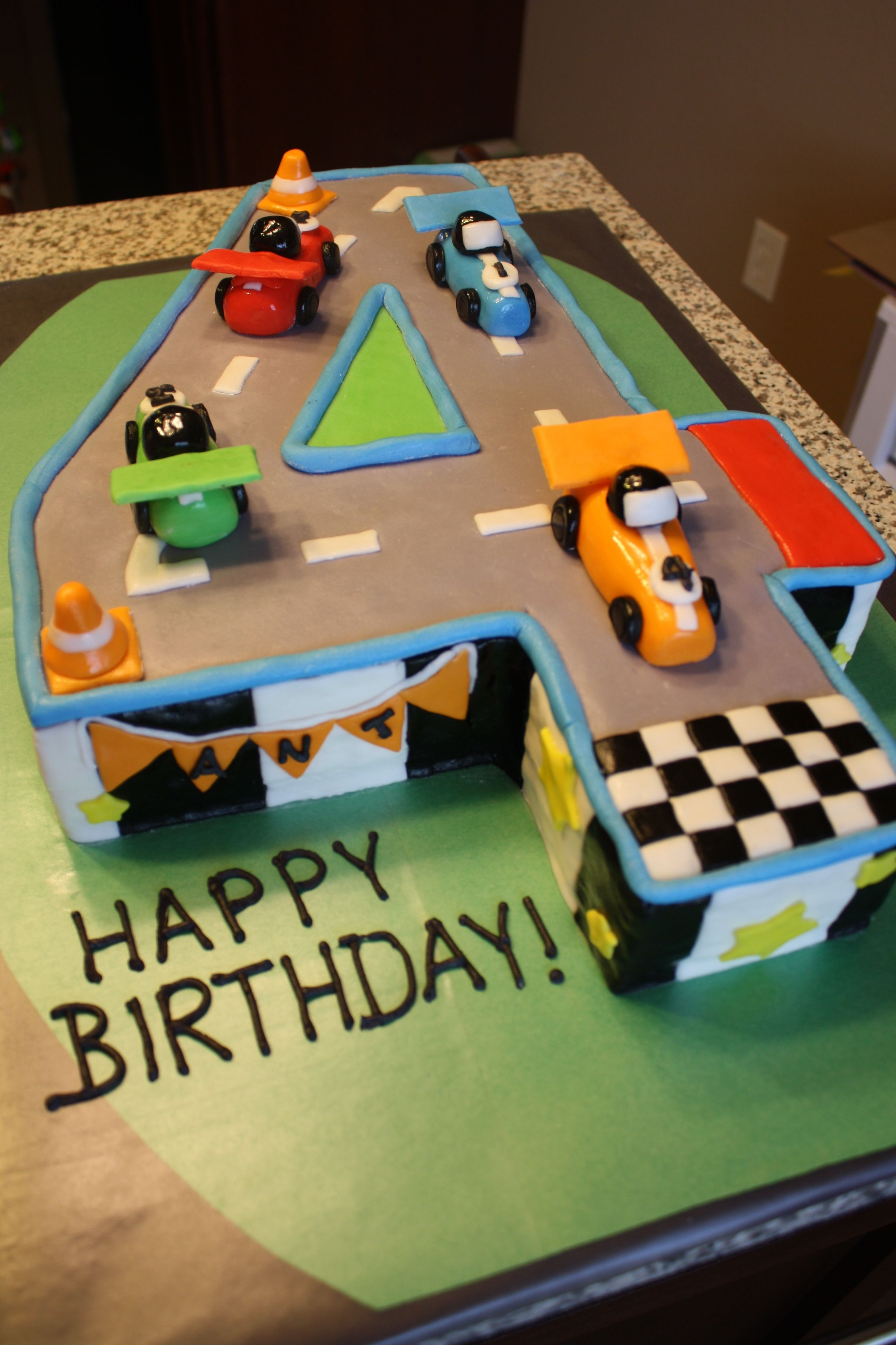 Race Car 4th Birthday Cake - My son wanted a race car cake for his 4th birthday, and he's very in to numbers right now - he just loved this!