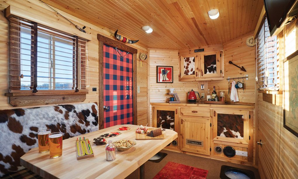 A ralph lauren inspired ice fishing house ice fishing for Fish house interior designs
