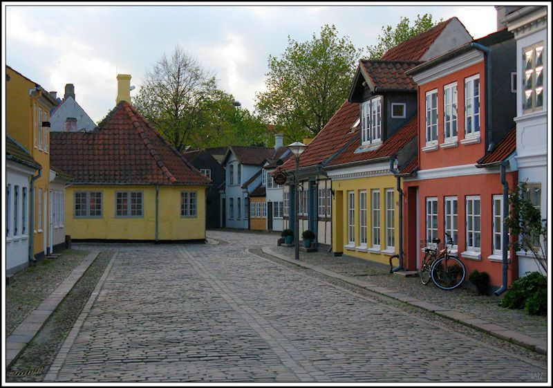 Denmark is located in Scandinavia and the main part of the country's land consists of a Jutland, which is a peninsula that sits just north of Germany. Description from traveldealscheap.com. I searched for this on bing.com/images
