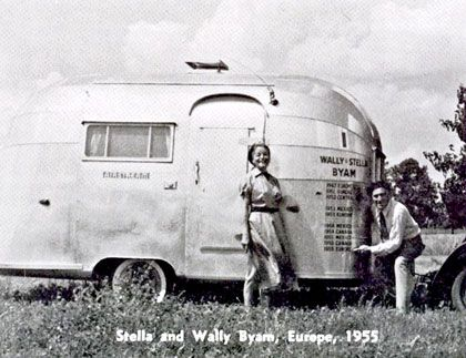 Wally and his wife happily surround their Airstream