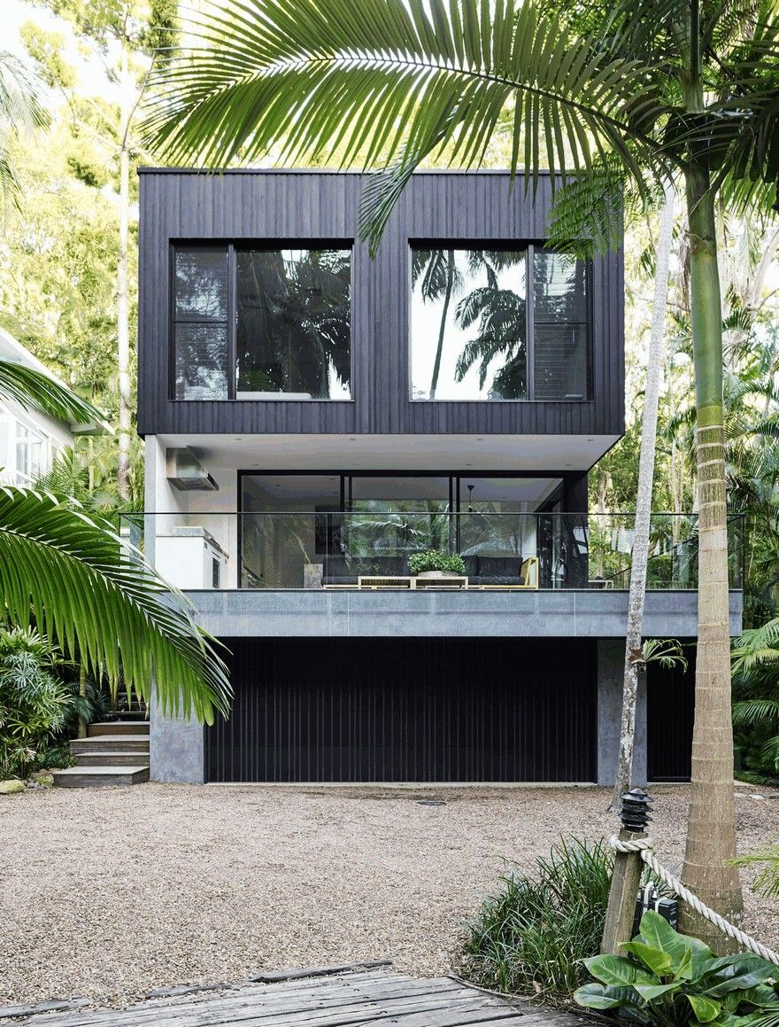 Modern coastal house nestled in the lush australian rainforest